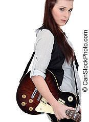 portrait of alluring brunette with electric guitar