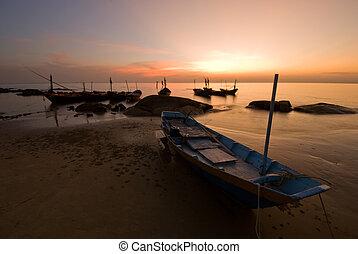 Romantic sunset - Small fishery boat over beautiful sunset...