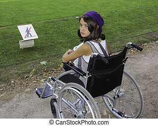 Young girl in wheelchair - A young girl in a wheelchair with...