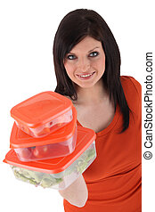 Woman with Tupperware-like plastic food boxes