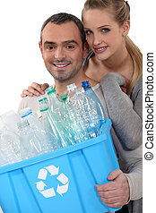 Couple taking out the recycling