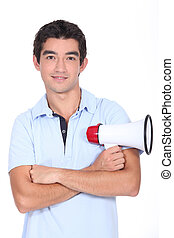 Young man holding megaphone
