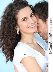happy couple embracing and kissing