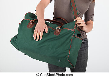 Body of woman with travel bag