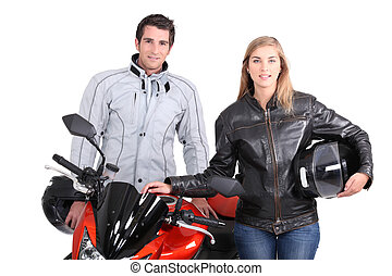 A man, a woman and a motorbike.