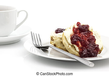 Home-baked scones with strawberry jam and clotted cream,...