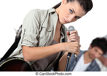 Female singer in a rock band