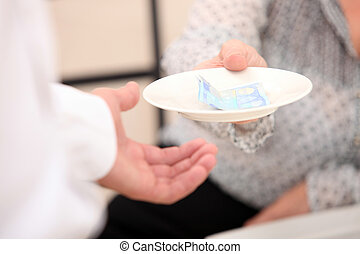 Customer handing money to waiter