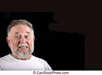 Old Man Embarrassed - An old man in a white t-shirt on a...