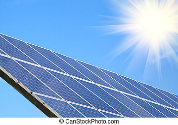 Solar panel against blue sky with sun