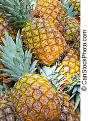 Pineapples - Fresh pineapples seen on a weekly fruit market