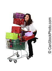 Woman pushing trolley full of presents