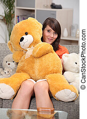 Woman hugging big teddy bear
