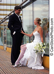 Newlywed couple on wedding day - Beautiful bride in white...