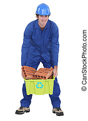 craftsman carrying a box with bricks