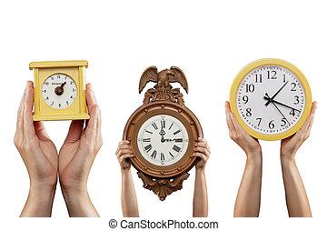 Three Clocks - Three sets of hands are holding three...