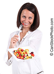 a woman showing a plate of fruits
