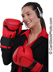 Customer service agent wearing boxing gloves