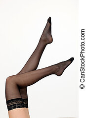 close-up of legs wearing sheer thigh high stockings