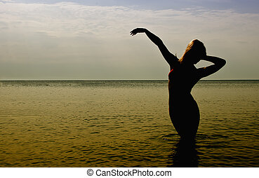 Silhouette of woman in the sea