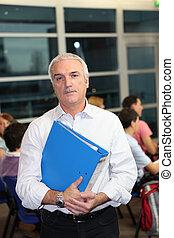A teacher supervising an exam