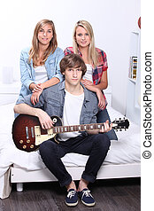 Teens with electric guitar