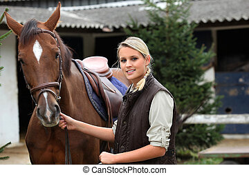 Blonde girl with horse