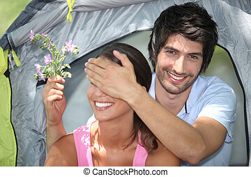 Young couple camping together