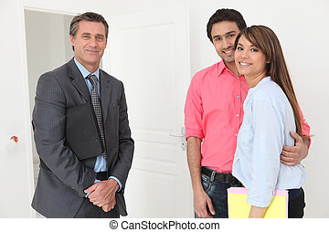 Young couple about to be shown around property