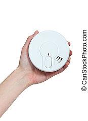 Hand holding a smoke alarm
