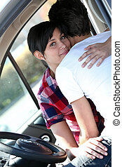 Embracing couple in a car