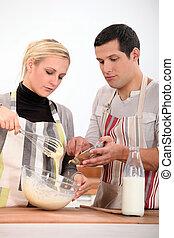 Couple preparing recipe
