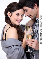 Couple toasting with champagne