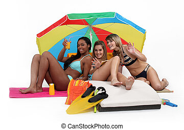Three women having a great time at the beach