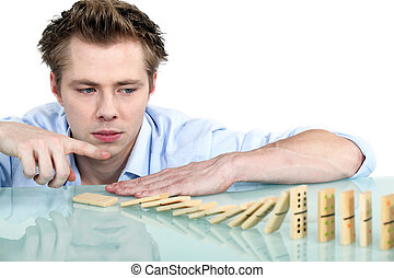Man playing with dominoes
