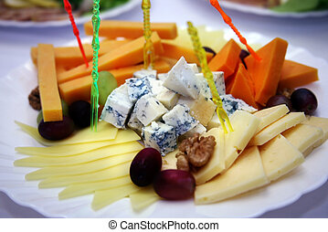 Cheese of different grades with olives
