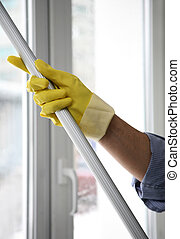 Cleaner - The cleaner washes a window