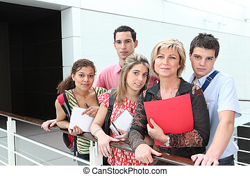 Teacher and students outside