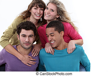 two couples posing together