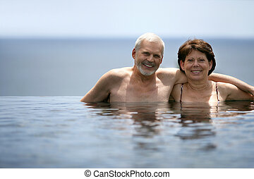Adult couple in swimming pool