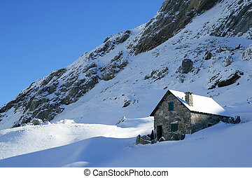 Mountain house in the snow
