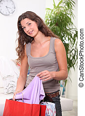 Woman looking through her shopping bags