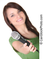 Woman holding a microphone