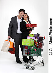 Couple with car full of gifts