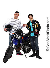 Men with motorbike and gold cup