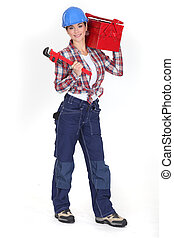 Woman holding a toolbox and a pipe wrench