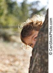 Girl playing peekaboo