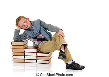 Young boy with encyclopedia - Young boy, prodigy next to...