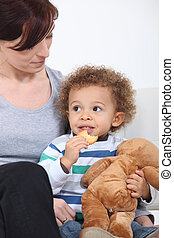 Woman and child with a teddy bear