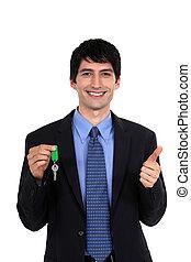 Car salesmen holding keys